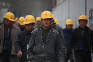 a group of china workers with yellow helmets