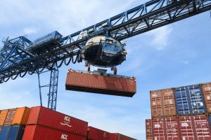 container picked up by crane daytime