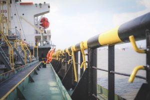 focused on railing, two seafarers on ship deck