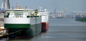 two freighters in green white and red
