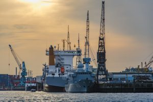 cargo vessel at port during sunset