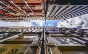 tight upshot of a container with a slither of cloudy blue sky