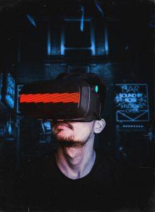 man wearing vr headset in a dark room