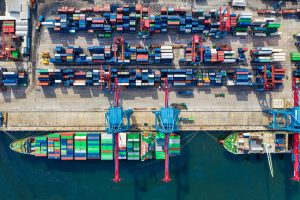 port aerial view top down angle, bright day, hundreds of containers