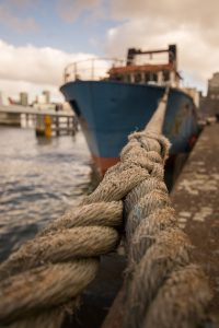 point of view from the rope to the ship docked at harbour