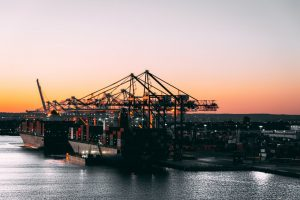 sunset port with cargo container ship docked
