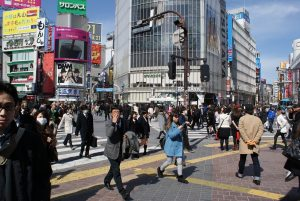Tokyo Shibuya crossing full of people during the day in the city centre