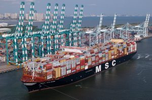 msc ship leaving port filled with containers