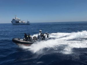 a team of coast guards patrolling the waters