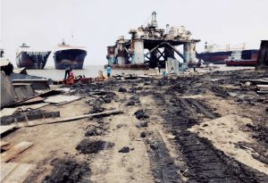 debris site of ship breaking with a couple of Indians