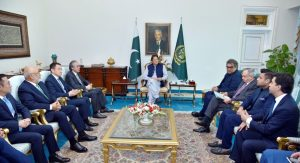 leaders in a meeting on multimillion dollar deal investment