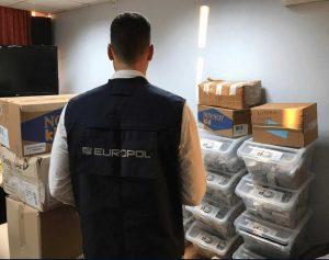 europol officer inspecting illegal goods
