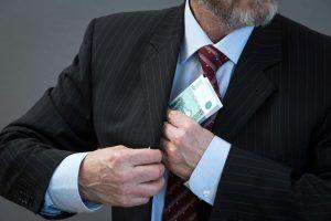 man hides money in his side pocket