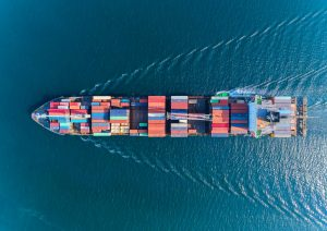 moving container ship in the ocean