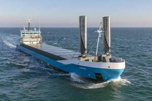 cargo ship wind propulsion econowind vessel whizzing through sea water