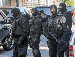 Europol four European men team with assault rifles armed weapon gun black full covered gear with head mask on