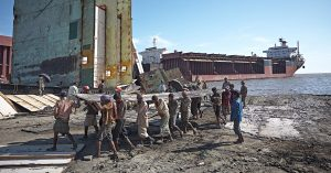 Chittagong Bangladesh, Indian workers carrying scraps manually, scrapping ships by hand, Shipbreaking labour, bulk carrier dismantled