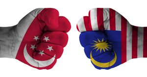 dispute between Singapore Malaysia, hand fist decorated with representative flag