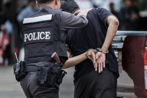 Police officer arrested man and handcuffed him