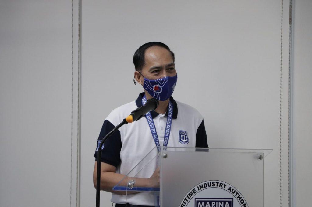 MARINA Administrator Vice Admiral Robert Empedrad wearing face mask speaking