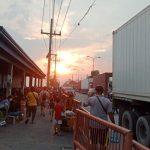 Filipino men waiting on the side shelter